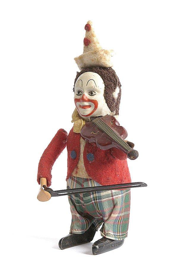 17: Schuco 986/2 Solisto Clockwork Clown Violinist