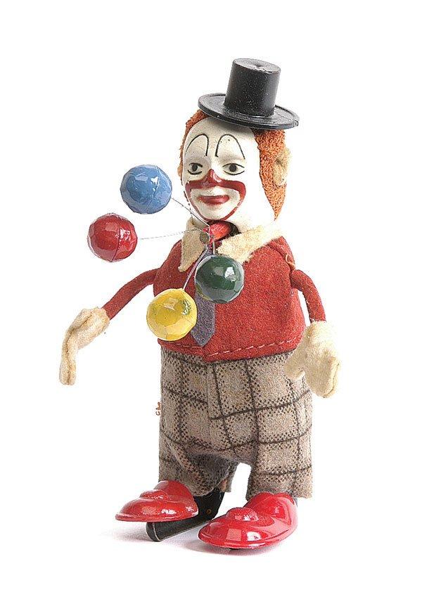 18: Schuco - 965 - Clockwork Clown Juggler