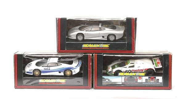 7: Scalextric - a group of 7 Jaguars
