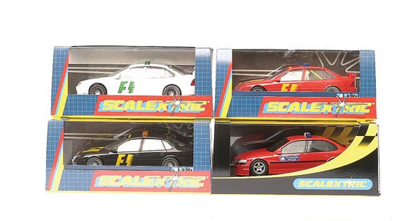 8: Scalextric - a group of 4 Vauxhall Vectra