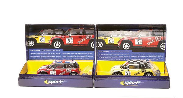 21: Scalextric - a group of 3 Mini Coopers