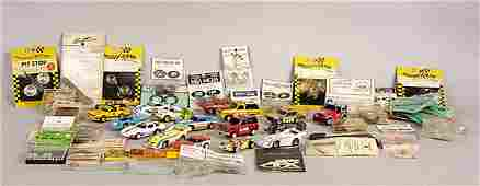 2589 A Large Group of Unboxed Slot Cars  Accessories