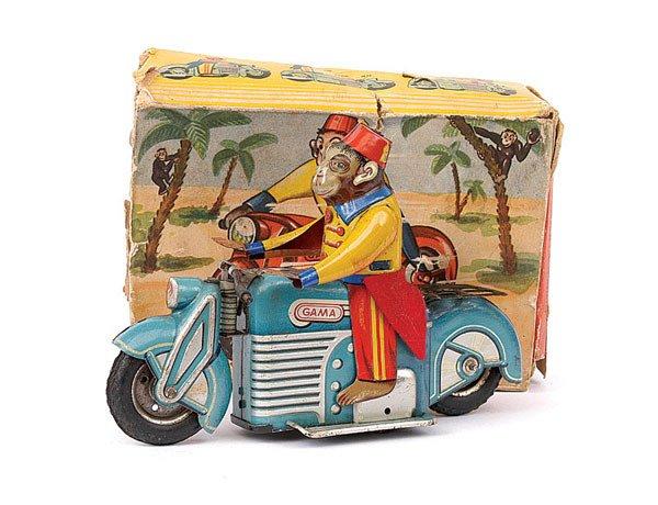 3023: Gama Ref.125 Tinplate Motorbike Monkey Acrobat