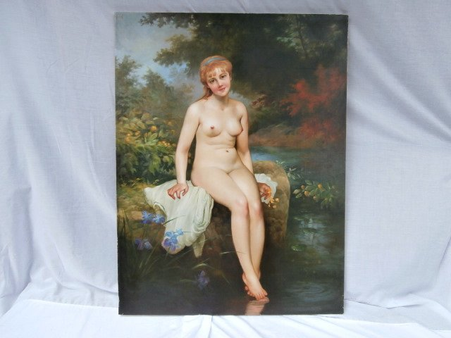 Nude Portrait young woman dipping toes in the water