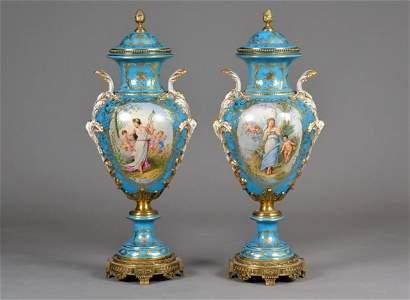 Pair of Sevres Porcelain Covered Vases   *