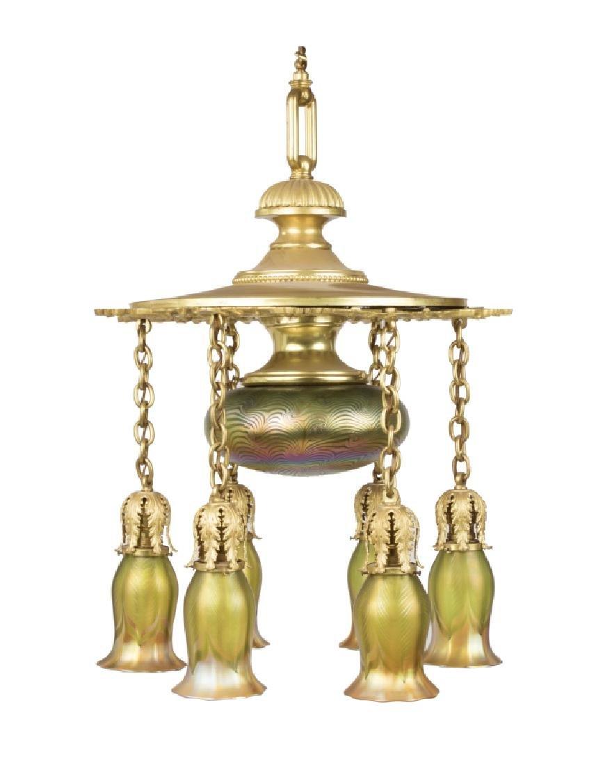 A gilt-metal and Quezell art glass chandelier