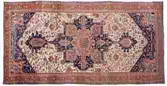 A Persian Heriz room-size Serapi rug