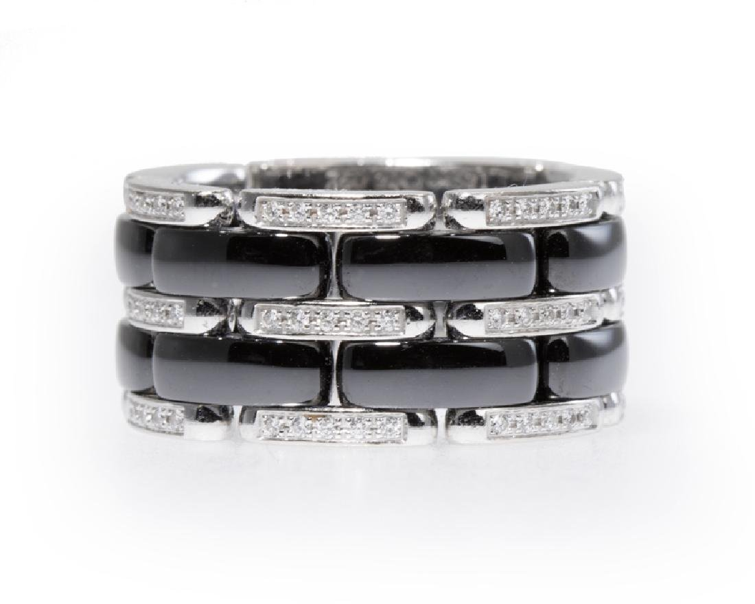 A black porcelain and diamond ring, by Chanel