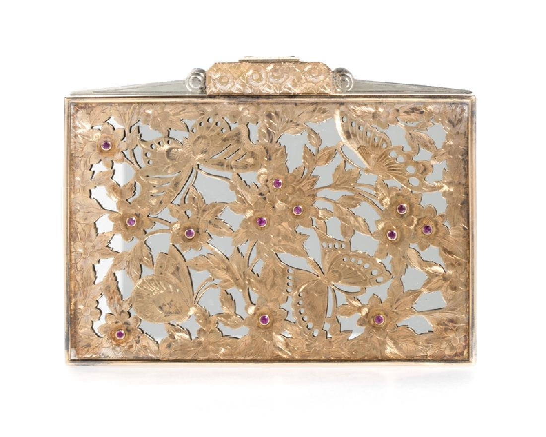 A ruby butterfly minaudiere, by Boucheron