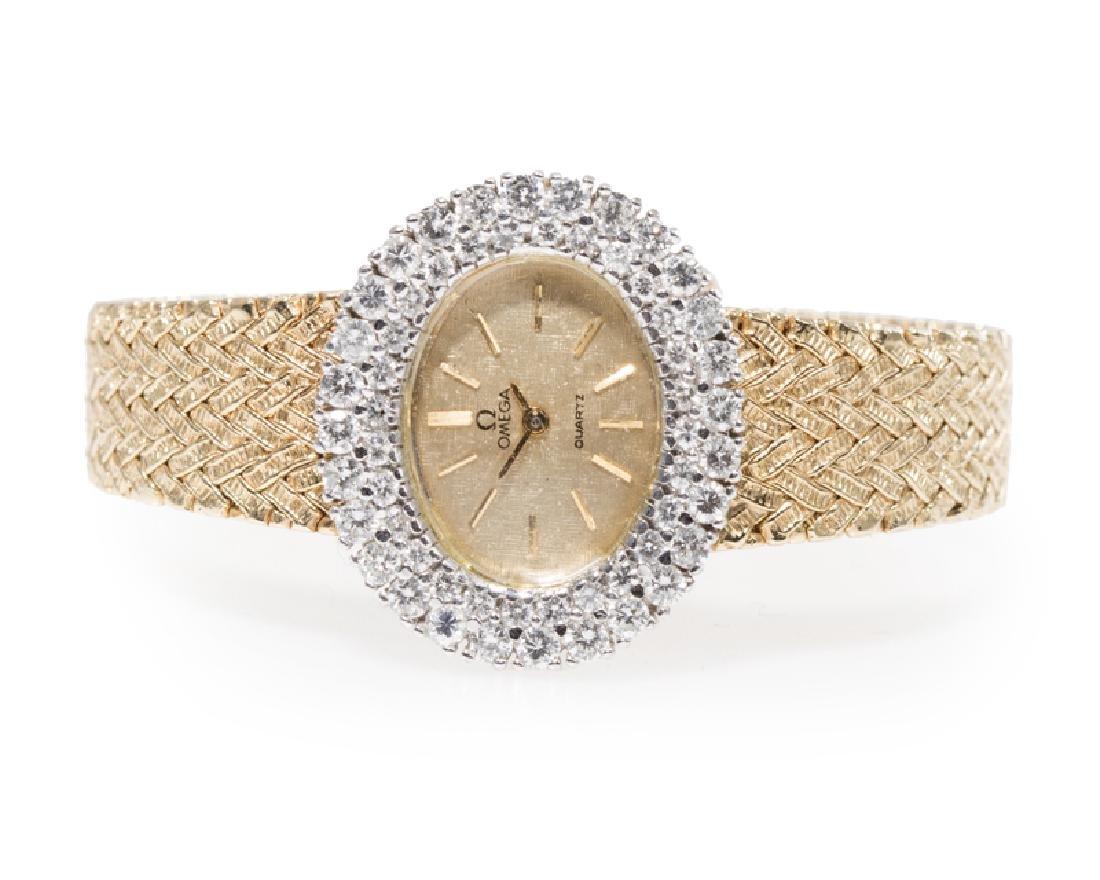 A diamond and gold quartz wristwatch, Omega