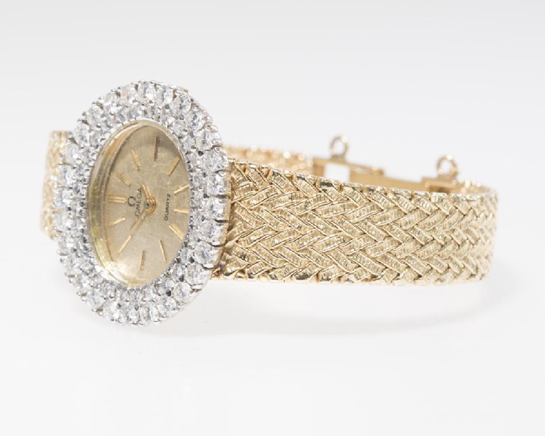 A diamond and gold quartz wristwatch, Omega - 3