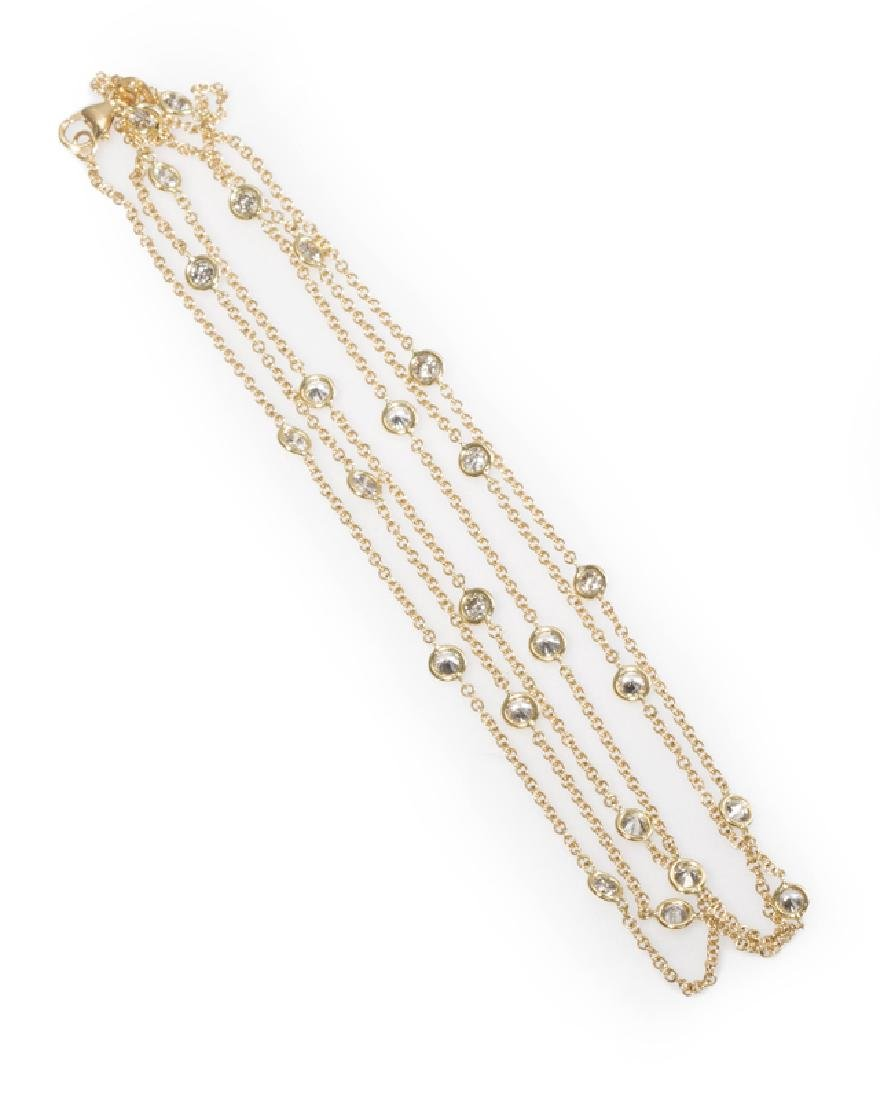 An Italian gold and diamond spectacle-link necklace