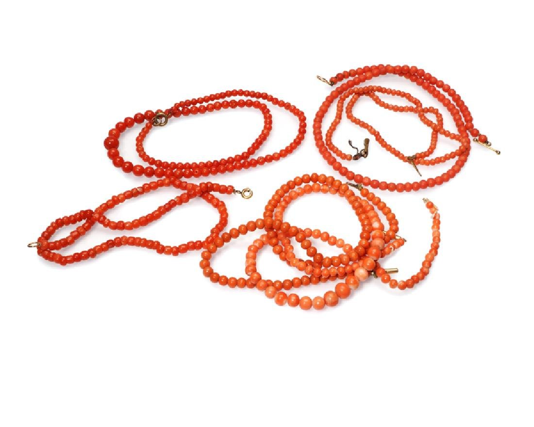 Six coral bead necklaces
