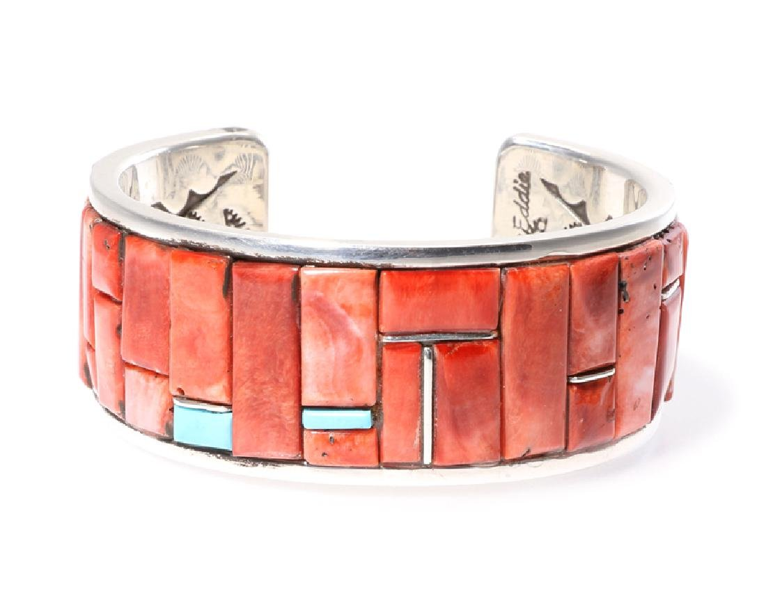 A Native American turquoise, coral and silver cuff