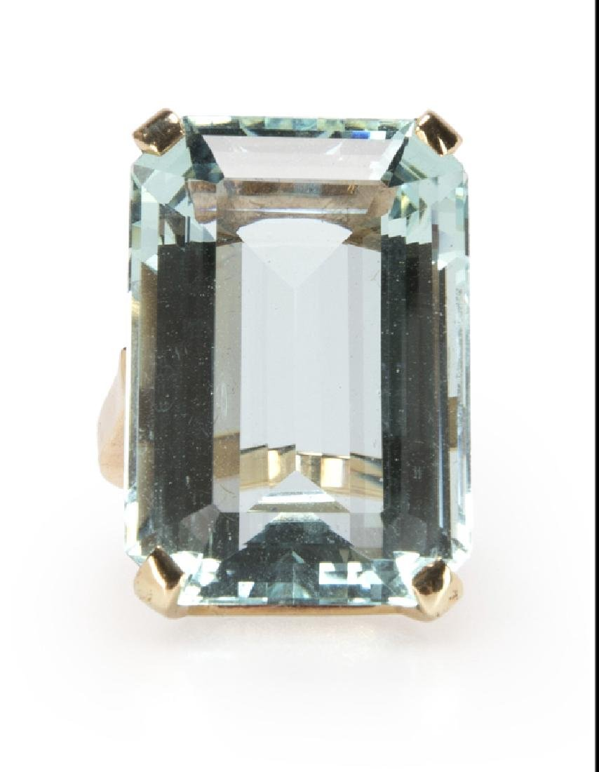 An aquamarine and gold ring