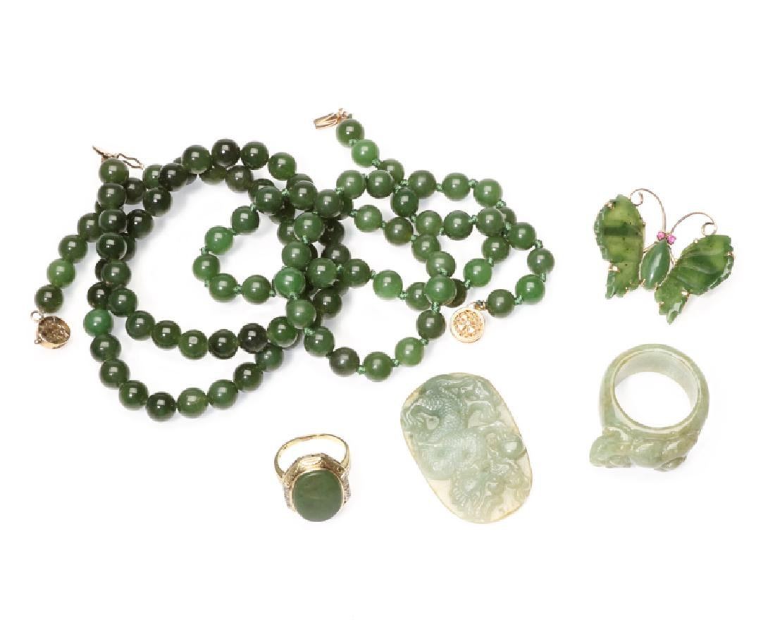 A group of nephrite jade jewelry