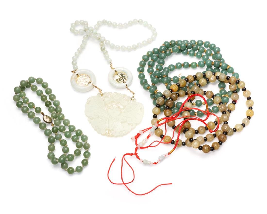 A group of five bead necklaces