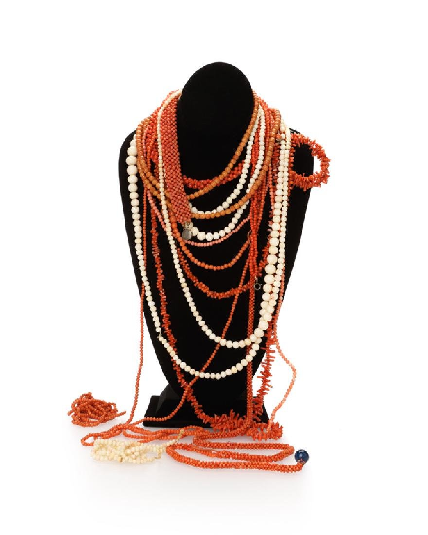 A group of coral bead jewelry