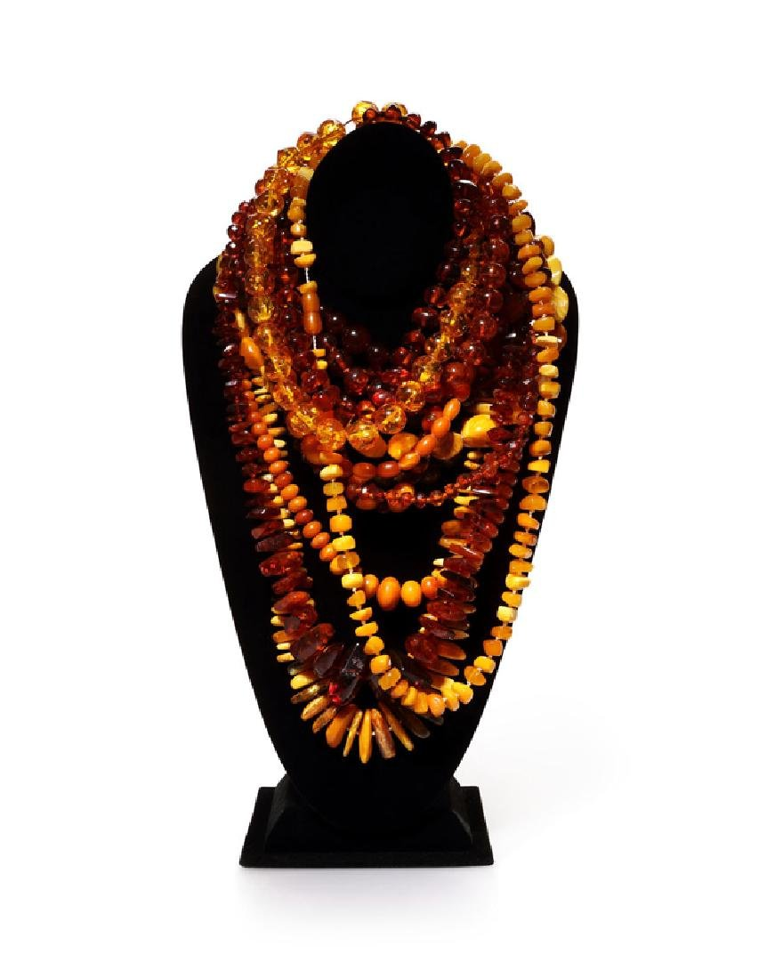 Fifteen various amber, resin and plastic bead necklaces
