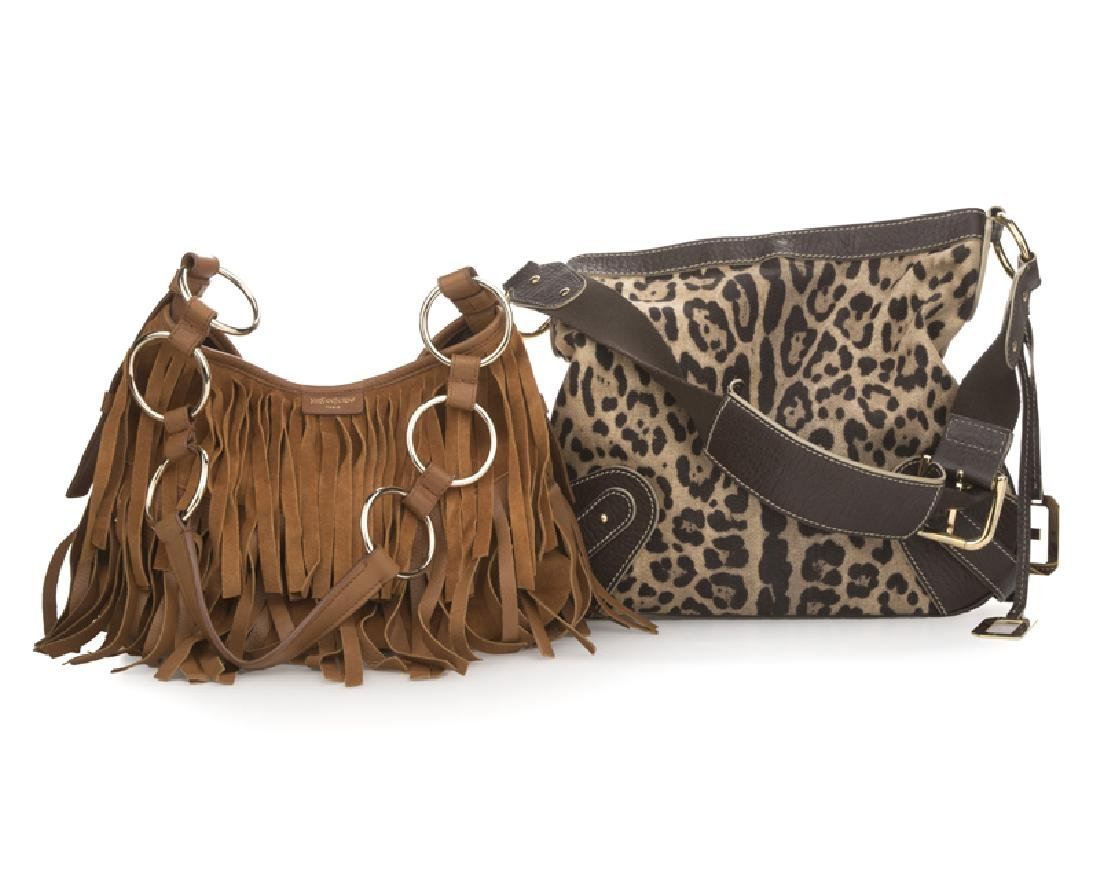 A group of two purses, one Dolce & Gabbana, one YSL