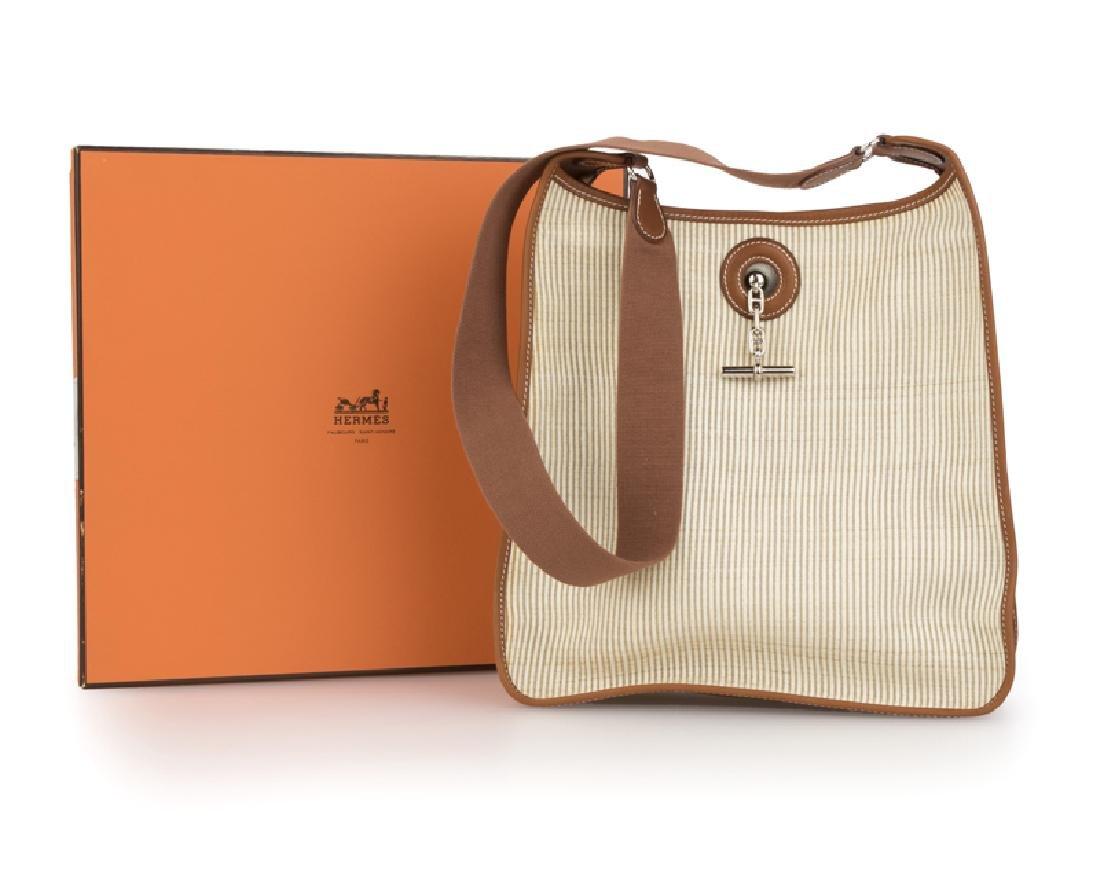 An Hermes Vespa PM shoulder bag, with original box