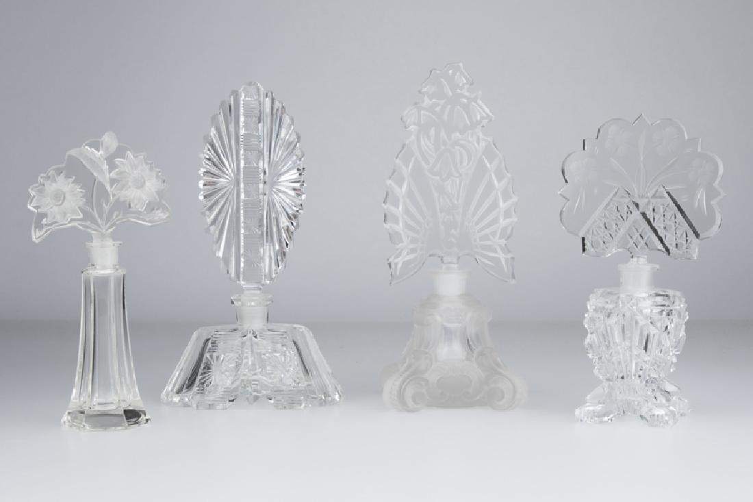 Four Czech cut-glass perfume bottles