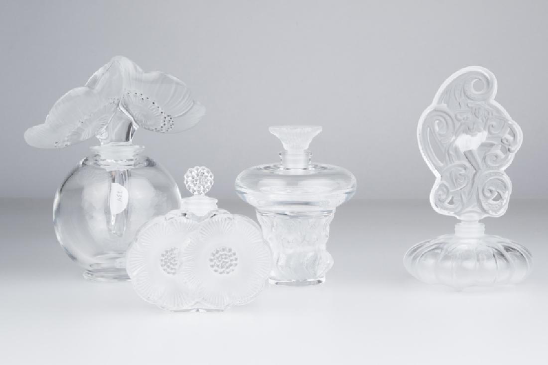 Four Lalique art glass perfume bottles