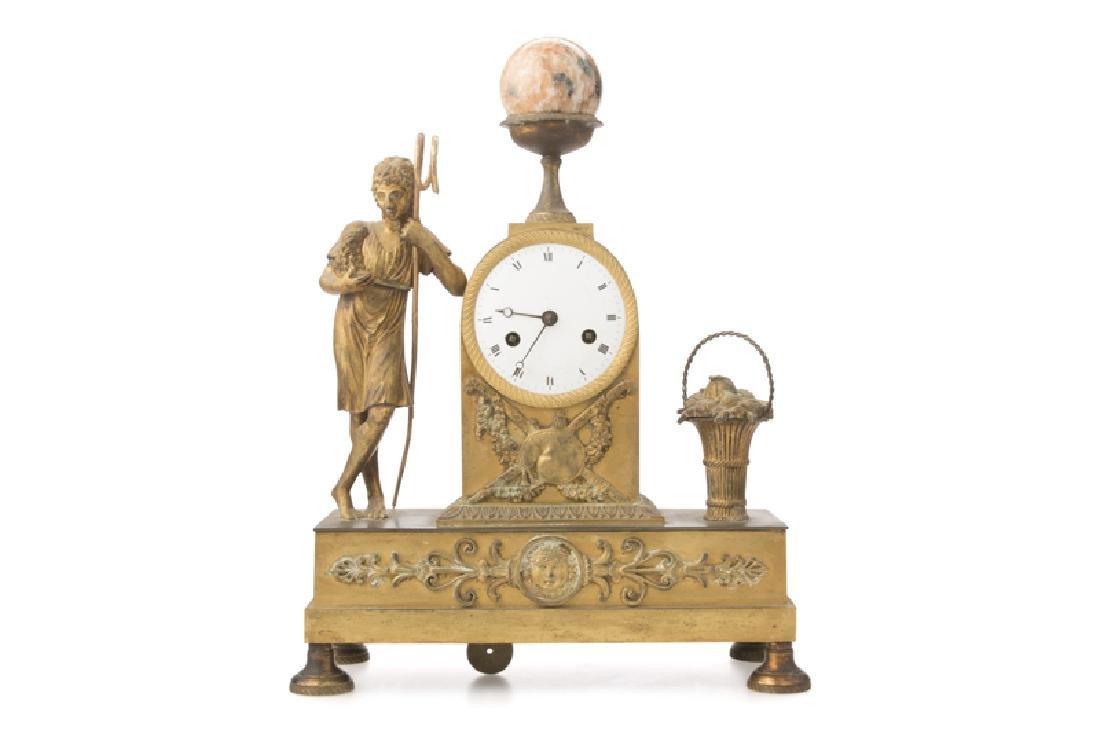 A French Louis XVI-style gilt-bronze mantel clock