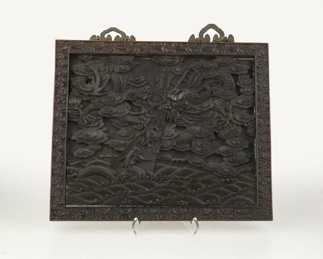 A Chinese carved wood panel