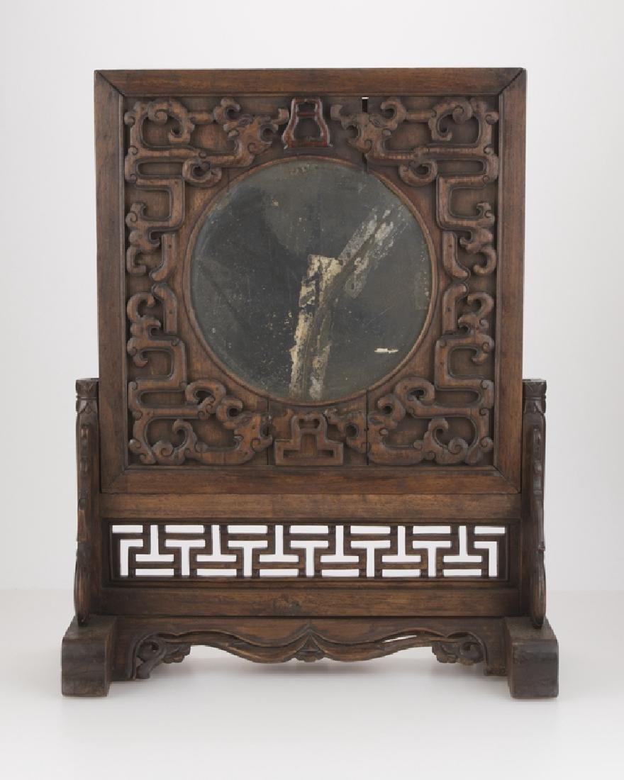 A Chinese carved hardwood table top mirror