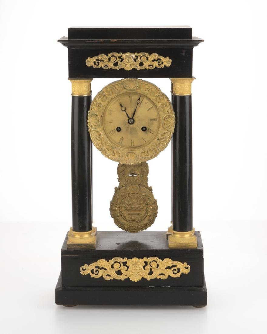 A French gilt bronze-mounted ebonized portico clock