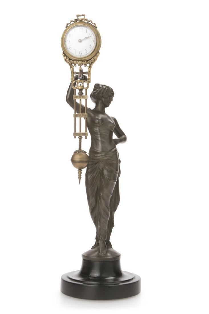 A figural Cleopatra swing clock