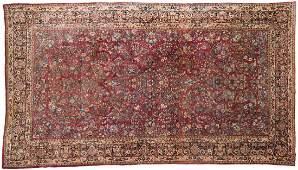 A Persian Sarouk room-sized rug