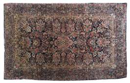 A Persian area rug Kerman variety
