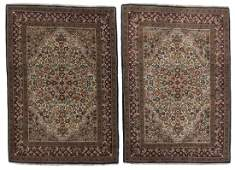 A pair of Persian area rugs