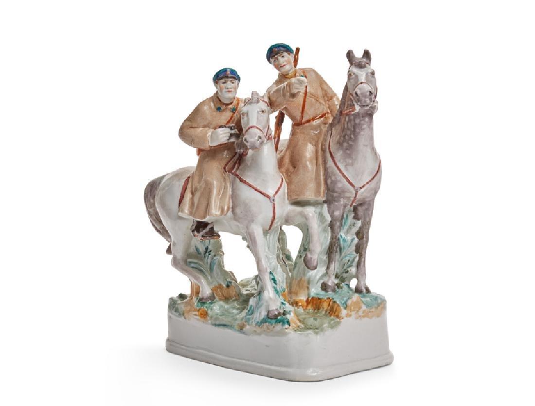 A Russian propaganda porcelain figural group, Soviet
