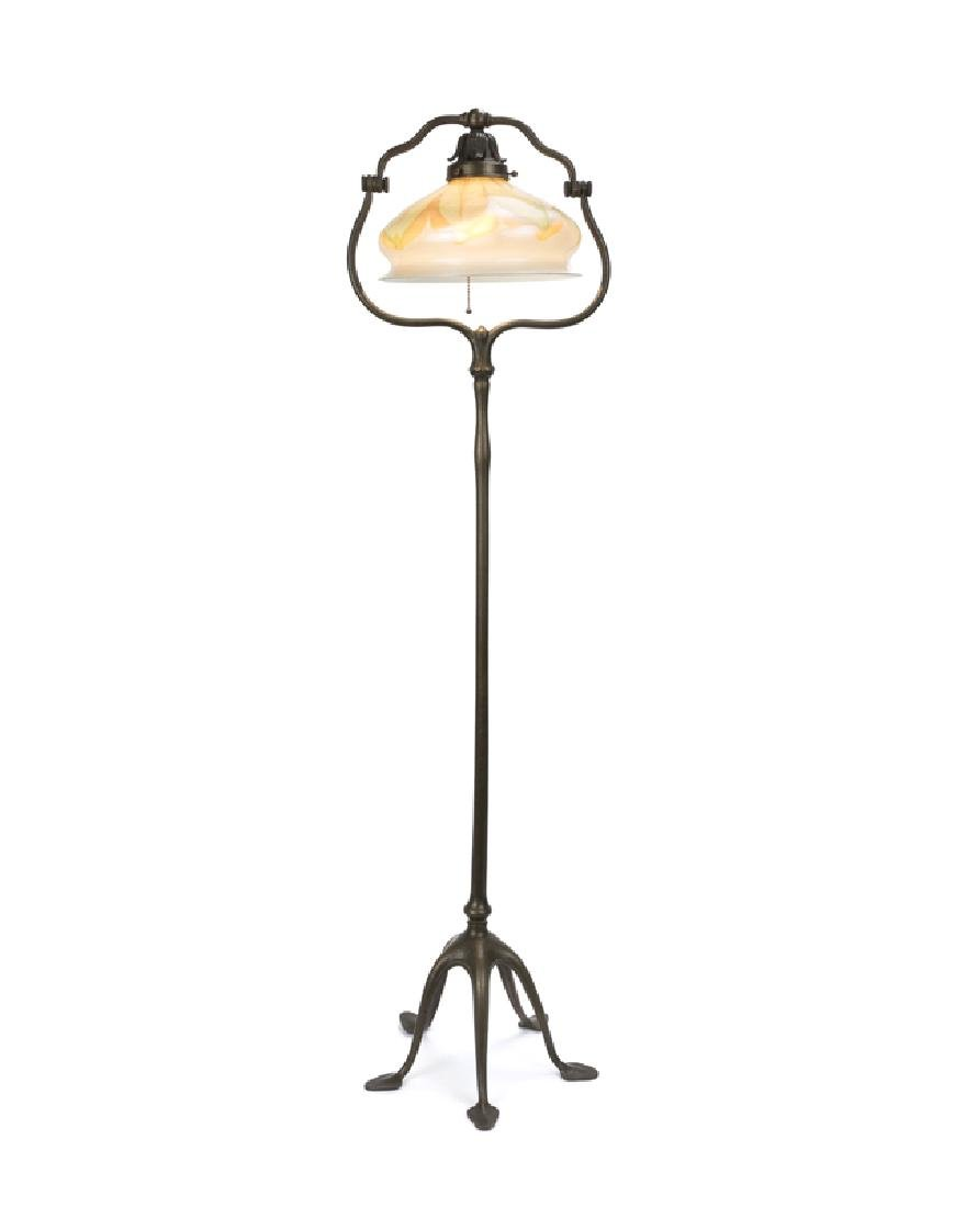 A Tiffany Studios bronze floor lamp with art glass