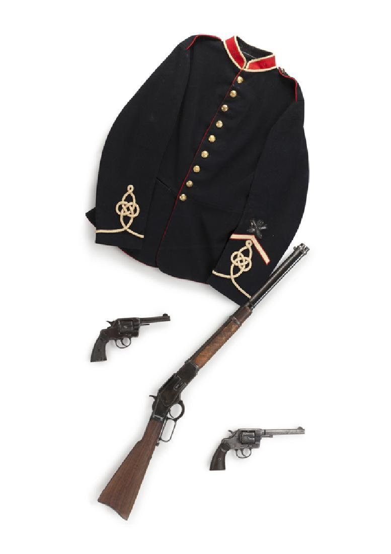 A framed collection of antique military items