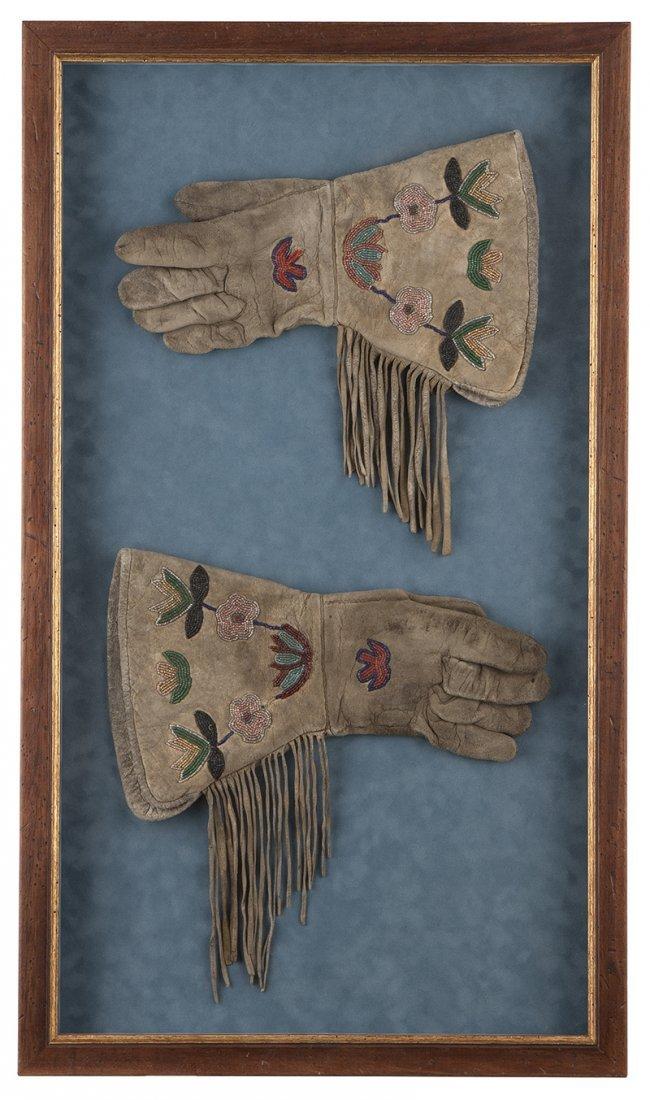 A pair of ''Buffalo Bill'' Cody Plains Indian gauntlets