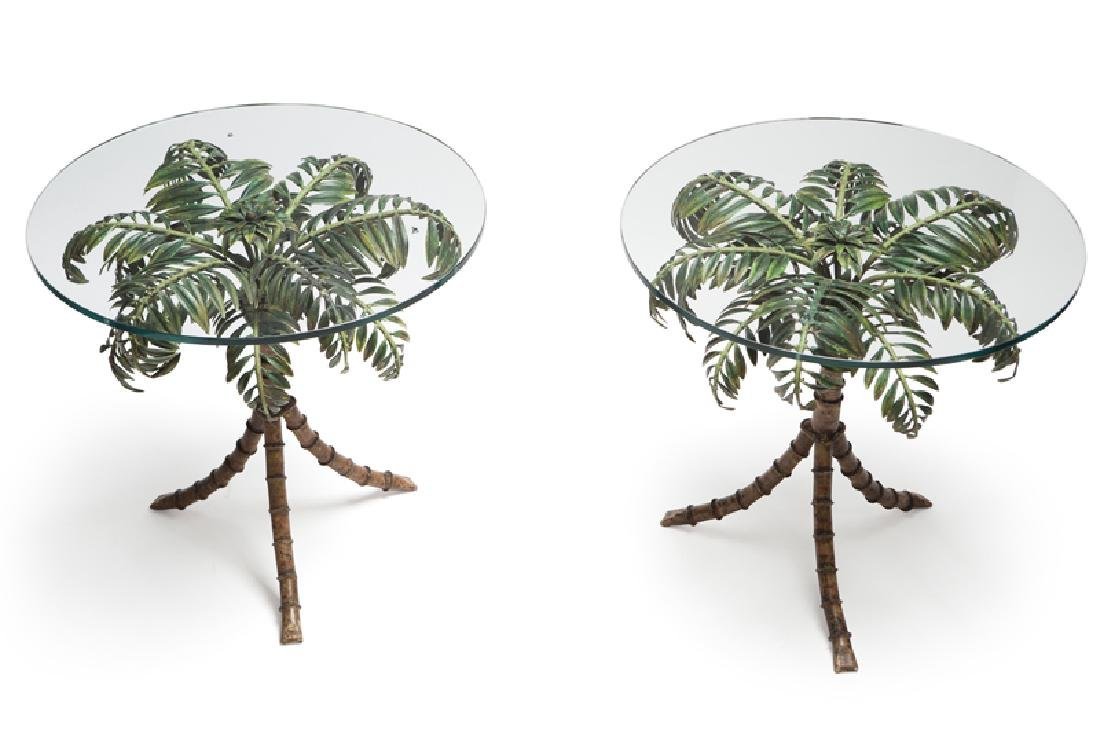 A pair of glass and metal side tables