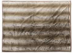 A Pierre Frey faux fur throw blanket