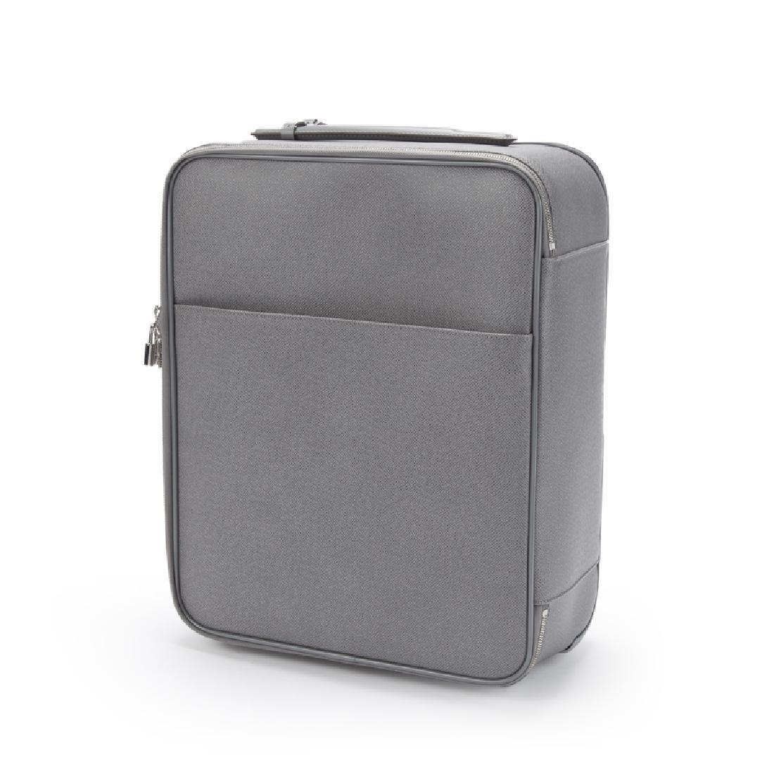 A Louis Vuitton Pegase 45 ''Glacier'' suitcase