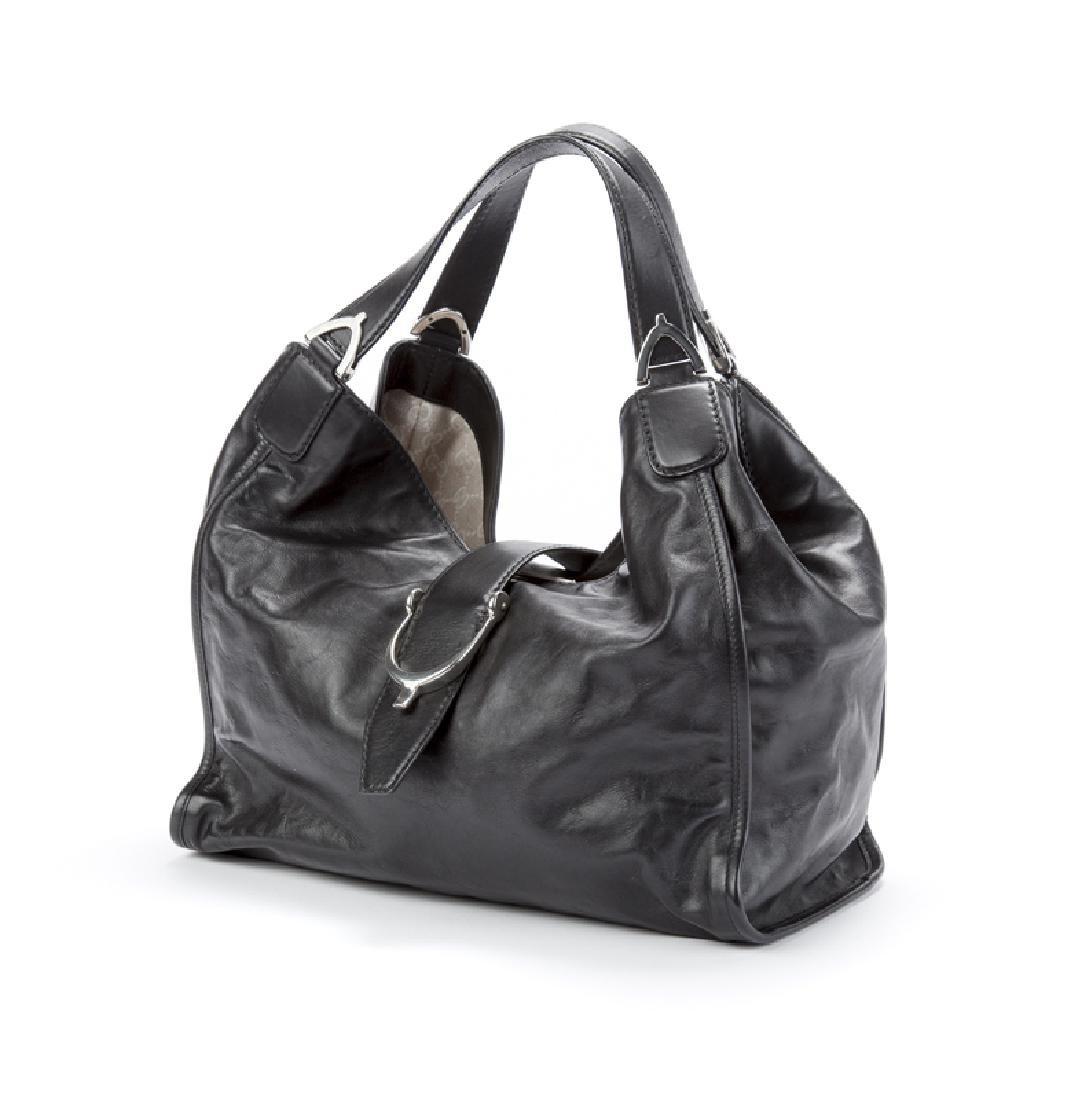 A large Gucci leather stirrup shoulder bag