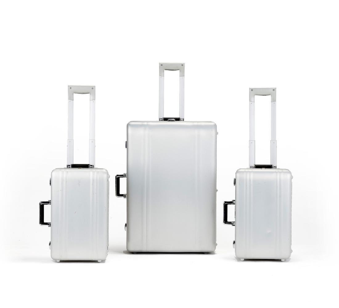 Three Zero Halliburton aluminum suitcases