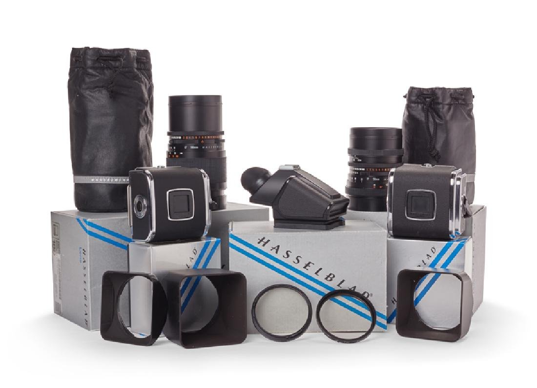 Two Hasselblad 180mm and 50mm lenses with accessories