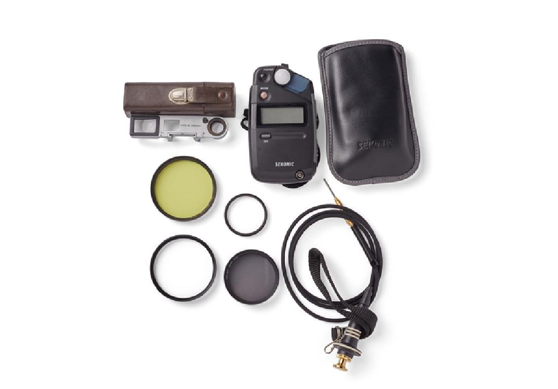 A group of camera accessories, including Leitz