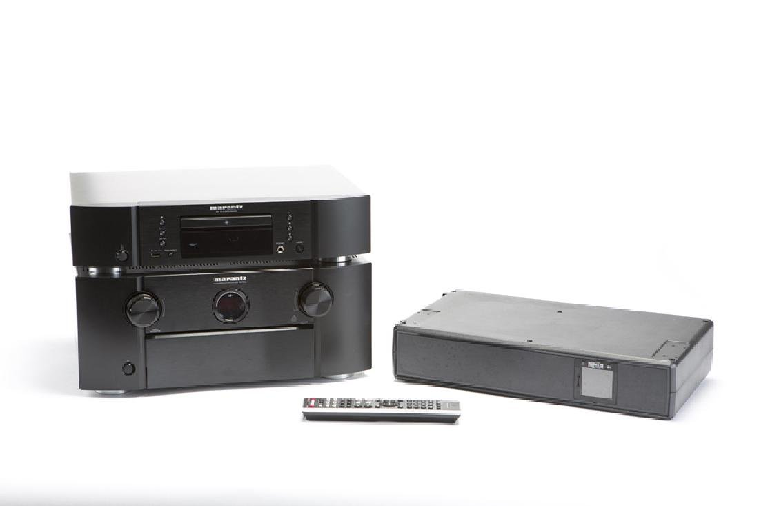 A Marantz receiver, CD player, and battery backup