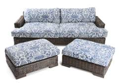 A Ralph Lauren rattan sofa and two ottomans
