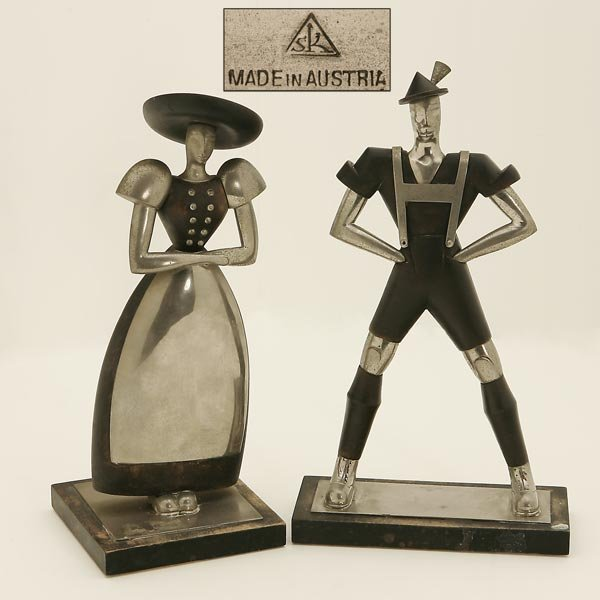 1003: A PAIR OF HAGENAUER STYLE CHROME & WOOD FIGURES