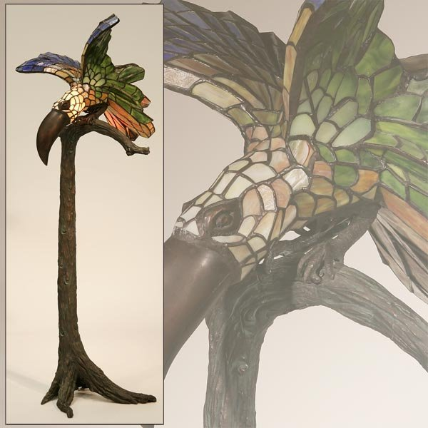 1004: A LEADED GLASS AND PATINATED BRONZE TOUCAN LAMP